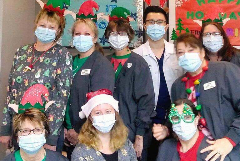 sim-68314-community-involvement-kristo marinette christmasstaffphoto