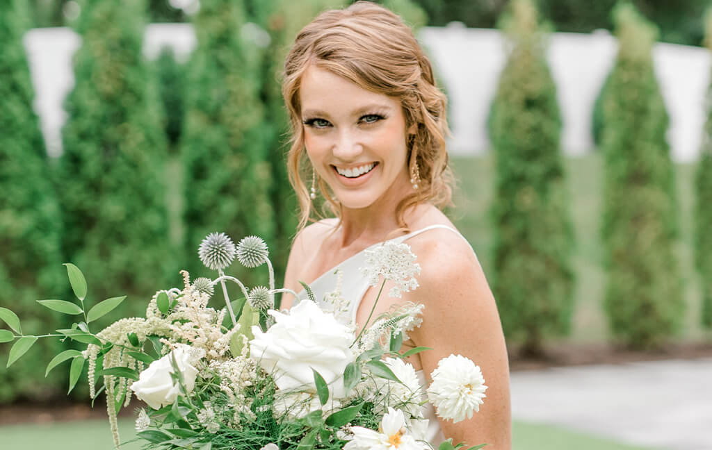 Girl smiling on wedding day with straight teeth